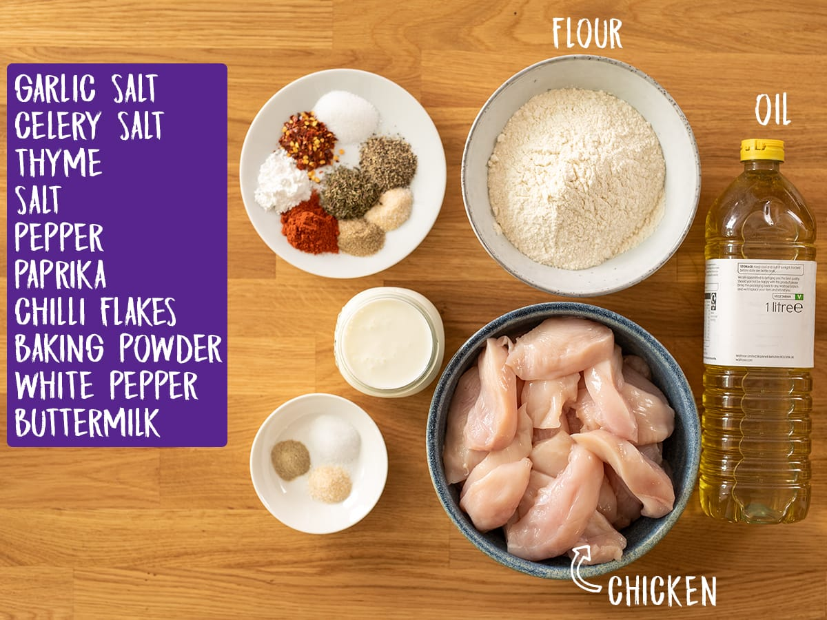 Ingredients for crispy chicken on a wooden table