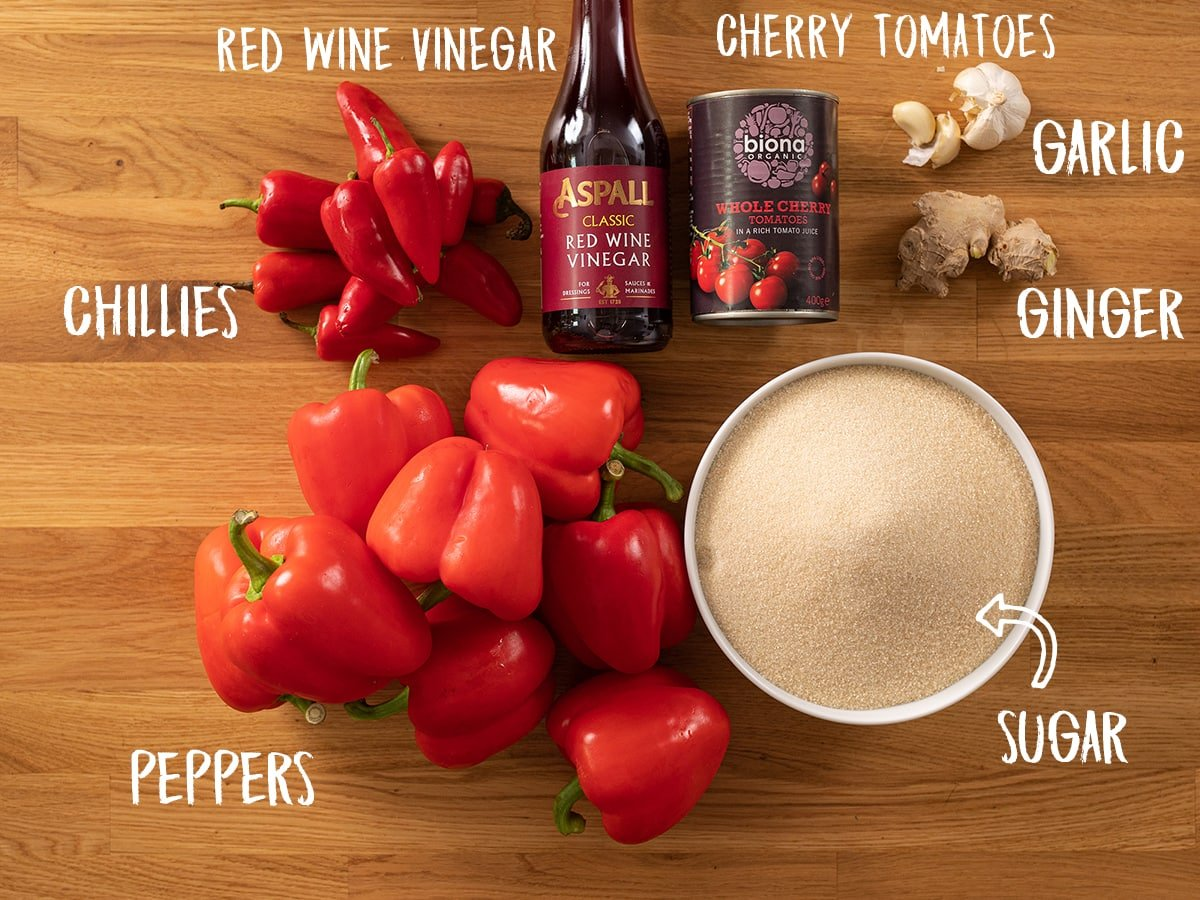 Ingredients for sweet chilli sauce on a wooden table