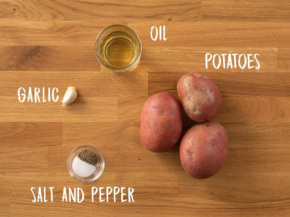 Ingredients for saute potatoes on a wooden table