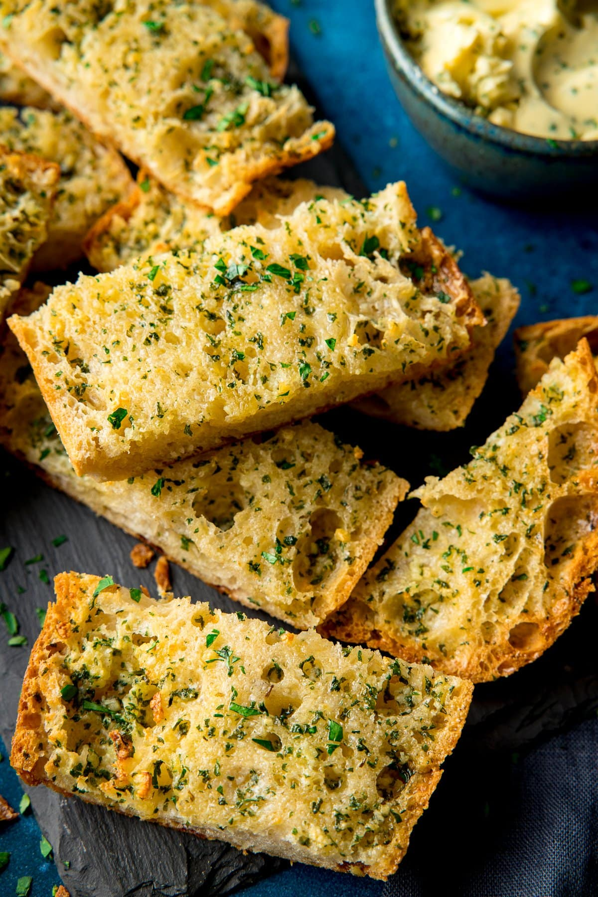 Slices of garlic bread on a piece of slate