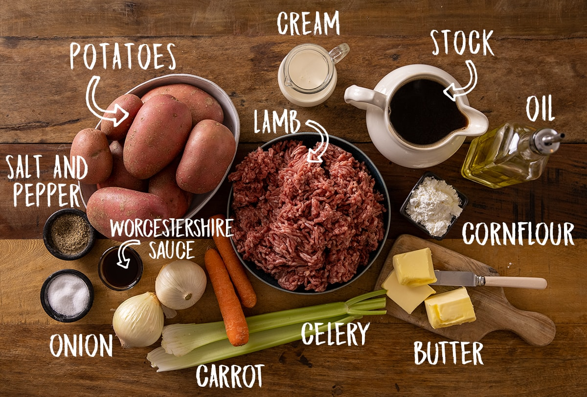 Ingredients for Shepherd's pie on a wooden table