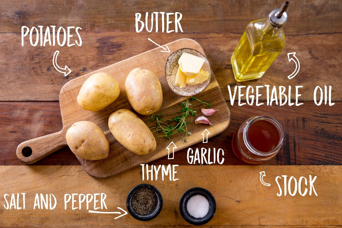 Ingredients for fondant potatoes on a wooden table