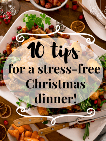 Square Infographic showing text for 10 tips for a stress-free Christmas dinner on the background of a Christmas dinner table filled with food.