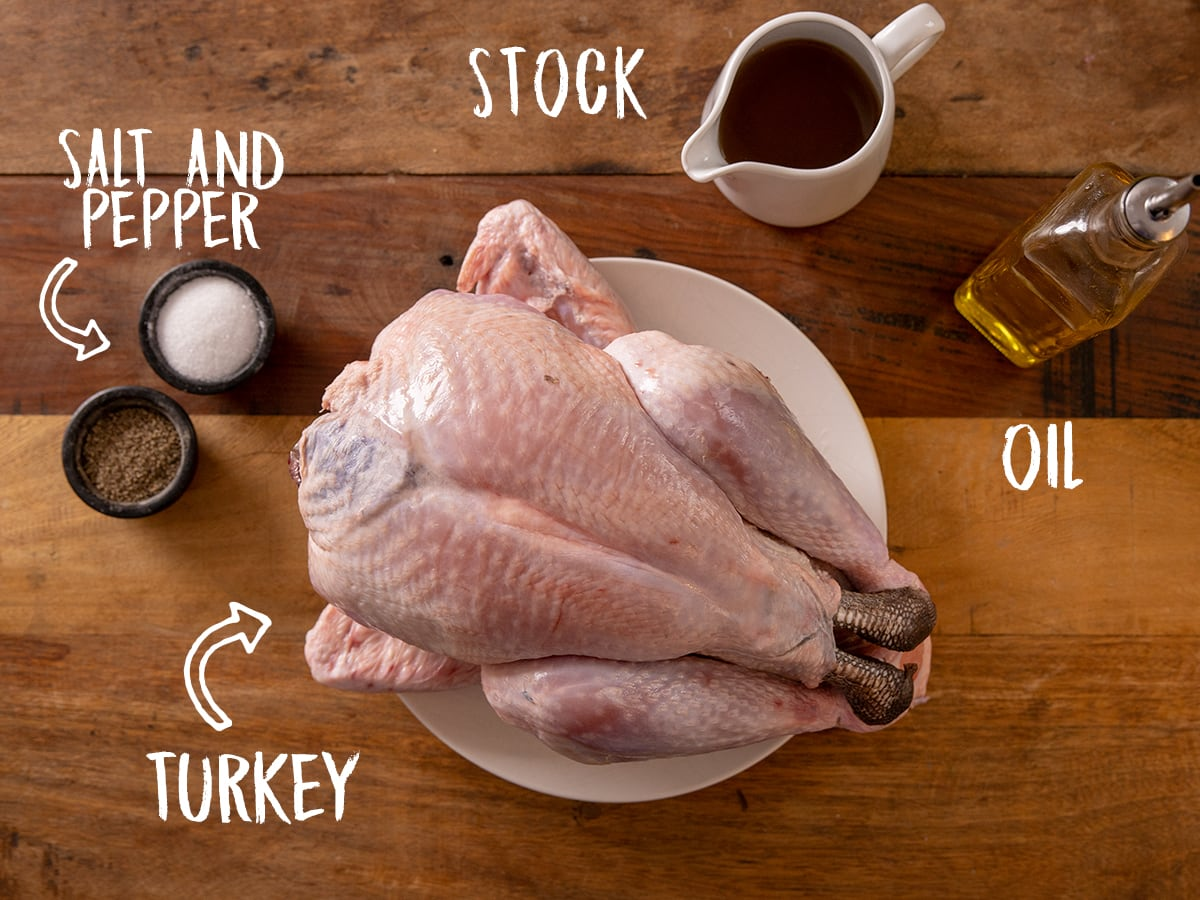 Ingredients for roast turkey on a wooden table