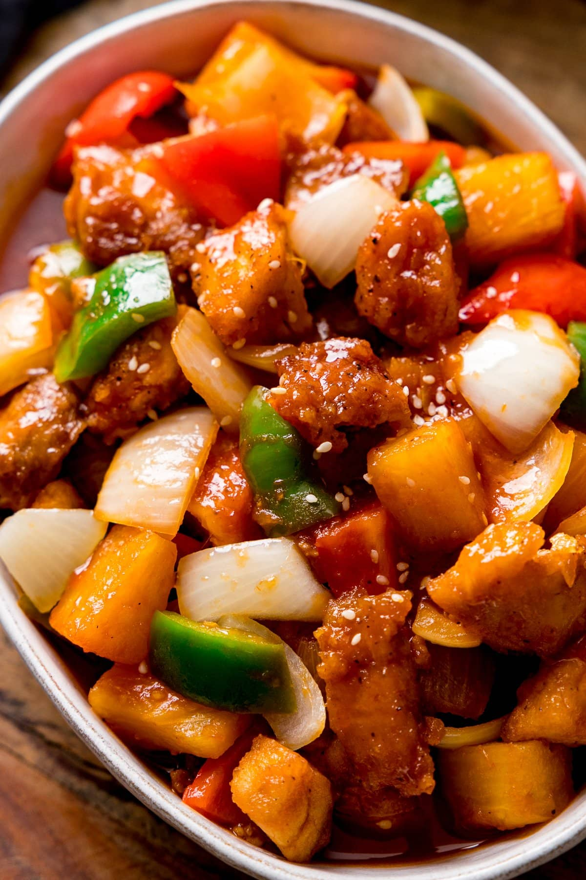 Close up of Sweet and sour turkey in a white bowl.