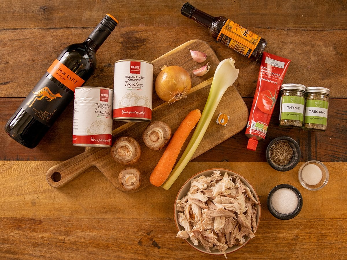 Ingredients for Leftover Turkey Bolognese on a wooden table