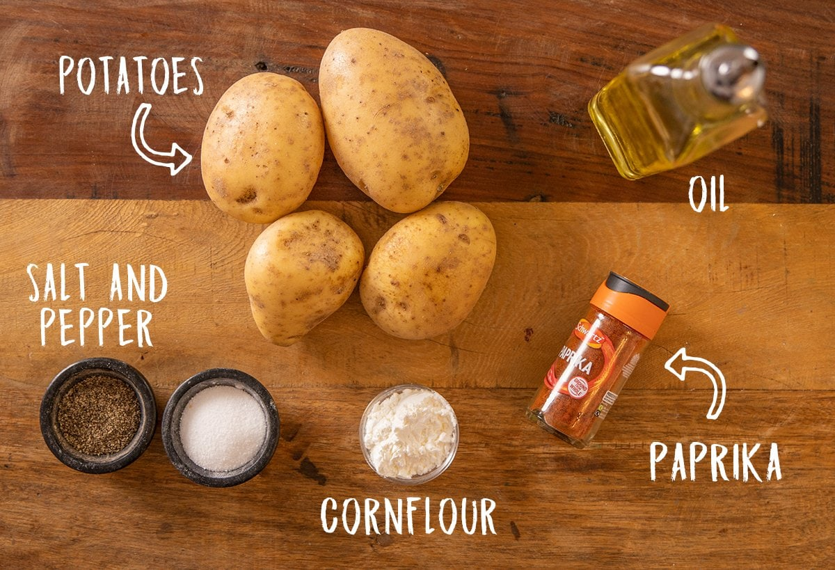 Ingredients for baked oven fries on a wooden background