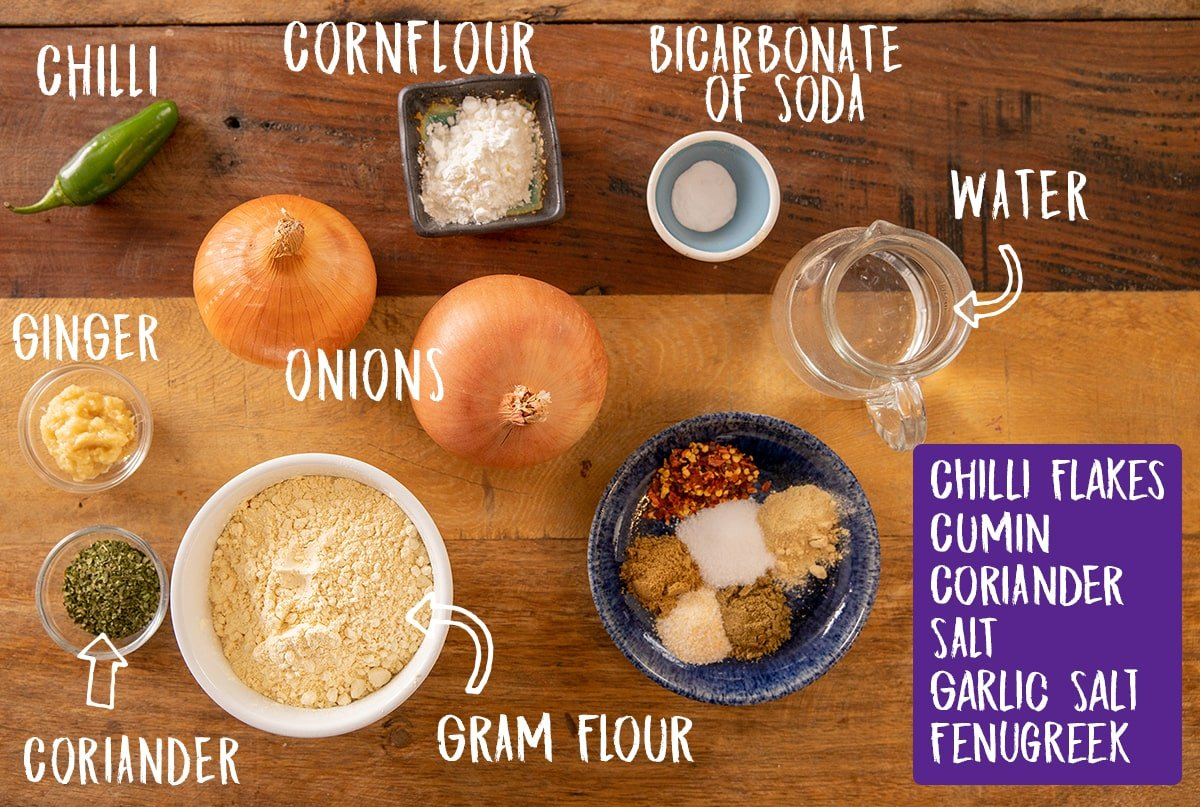 Ingredients for onion bhaji on a wooden table