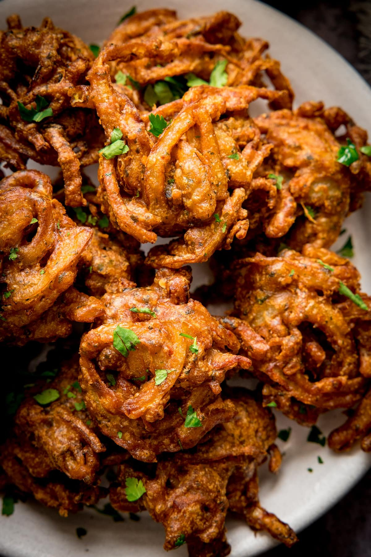 Close up of Onion bhajis on a white plate