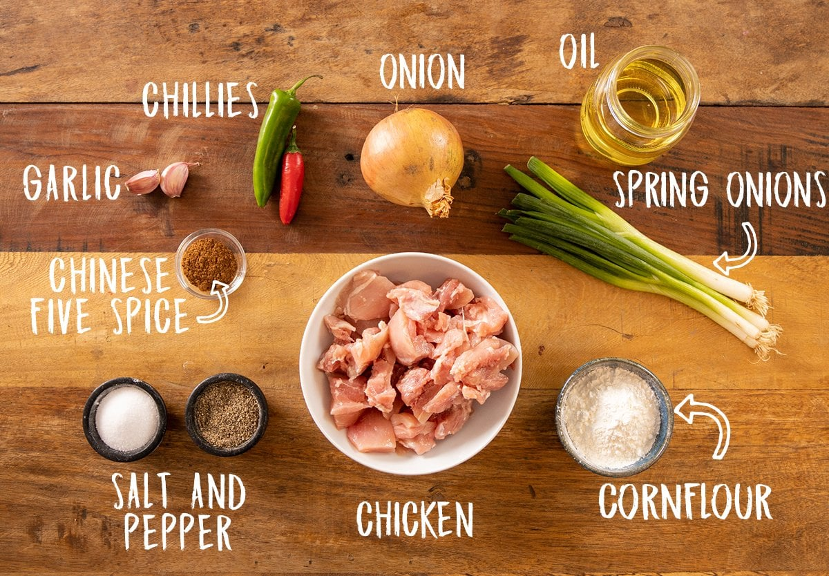 Ingredients for salt and pepper chicken on a wooden table