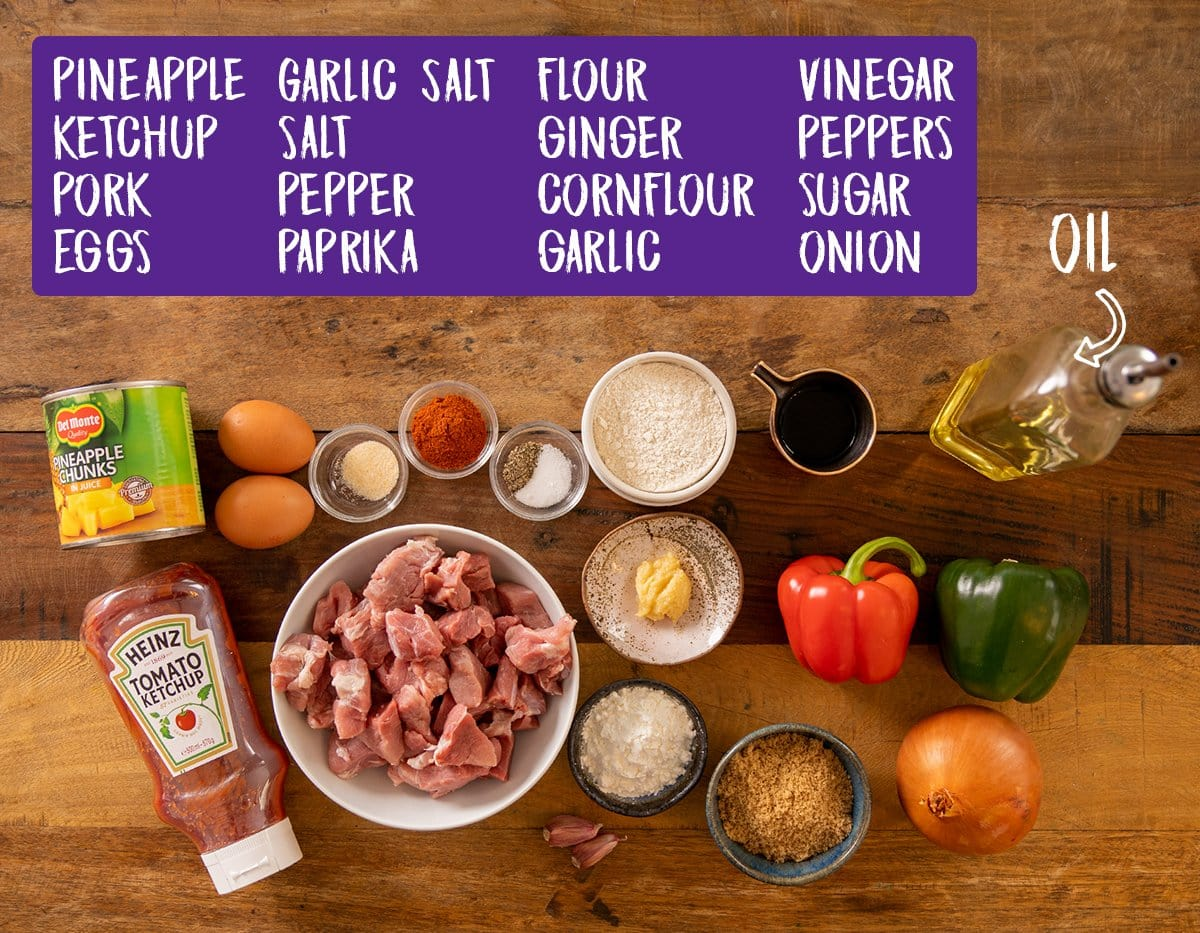 Ingredients for sweet and sour pork on a wooden table