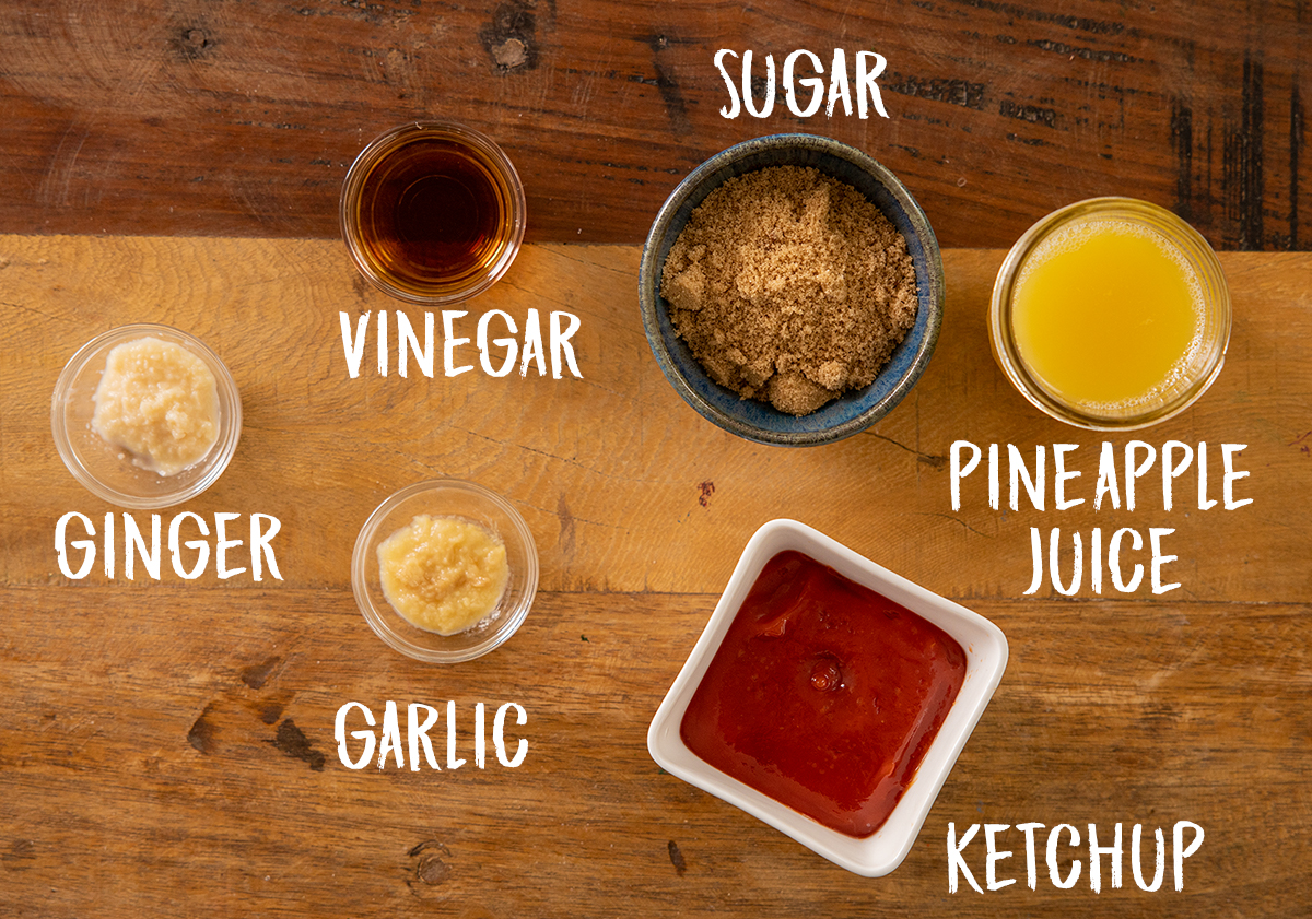 Ingredients for sweet and sour sauce on a wooden table