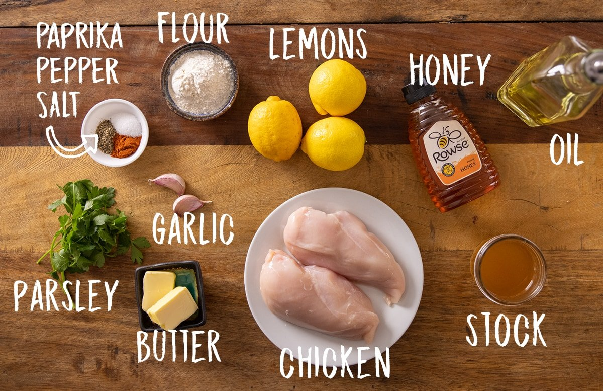 Ingredients for honey lemon chicken on a wooden table