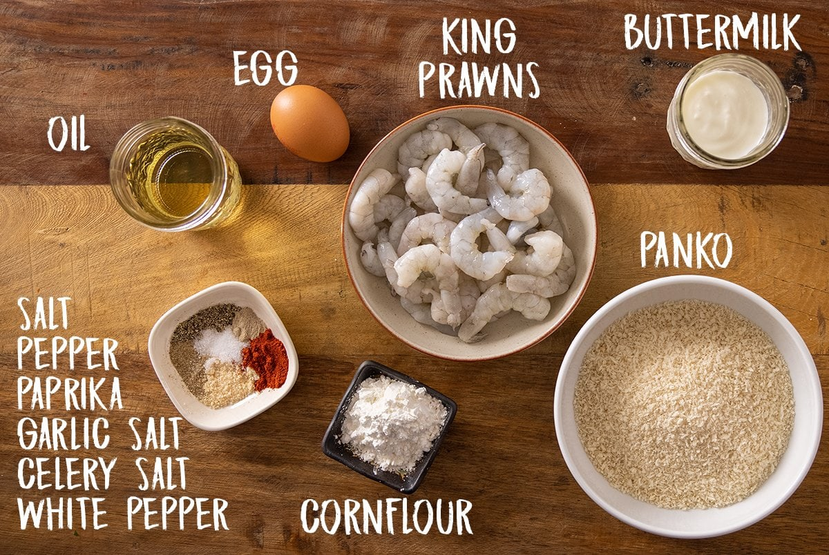 Ingredients for crispy shrimp on a wooden table.