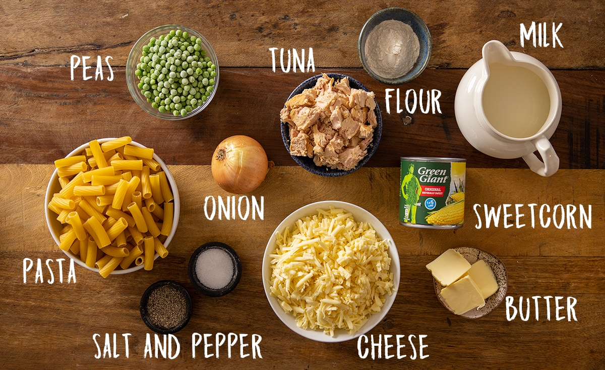 Overhead picture of Tuna Pasta Bake ingredients on a wooden background.