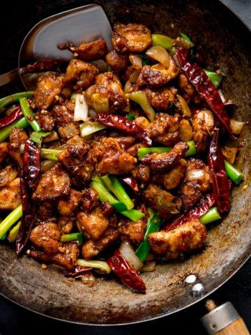 Szechuan chicken stir fry in a wok