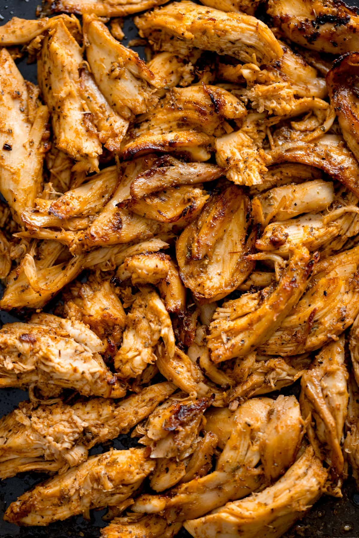Overhead shot of shredded, spiced, grilled chicken - ready for making chicken gyros.