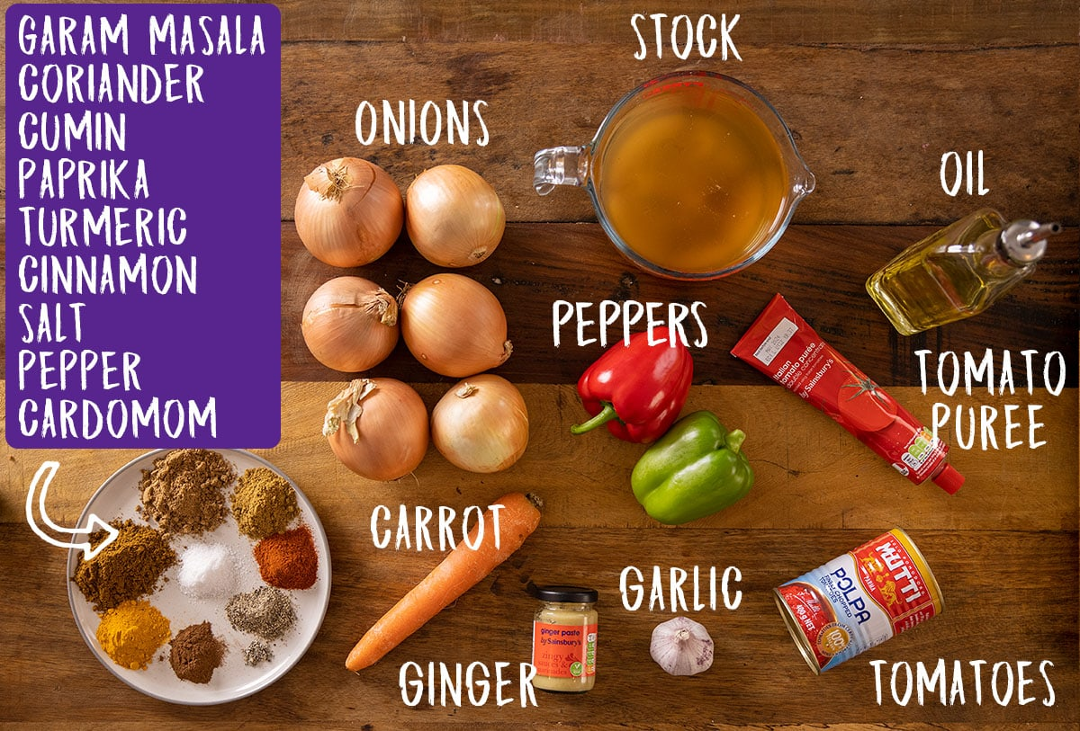 Ingredients for curry base gravy on a wooden table