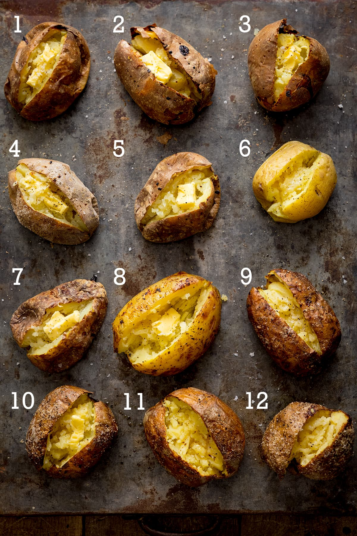 12 open baked potatoes on a metal tray - each with a number from one to ten.
