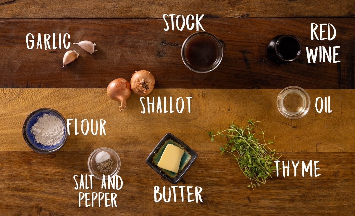 A wooden table with all of the ingredients laid out separately and labelled