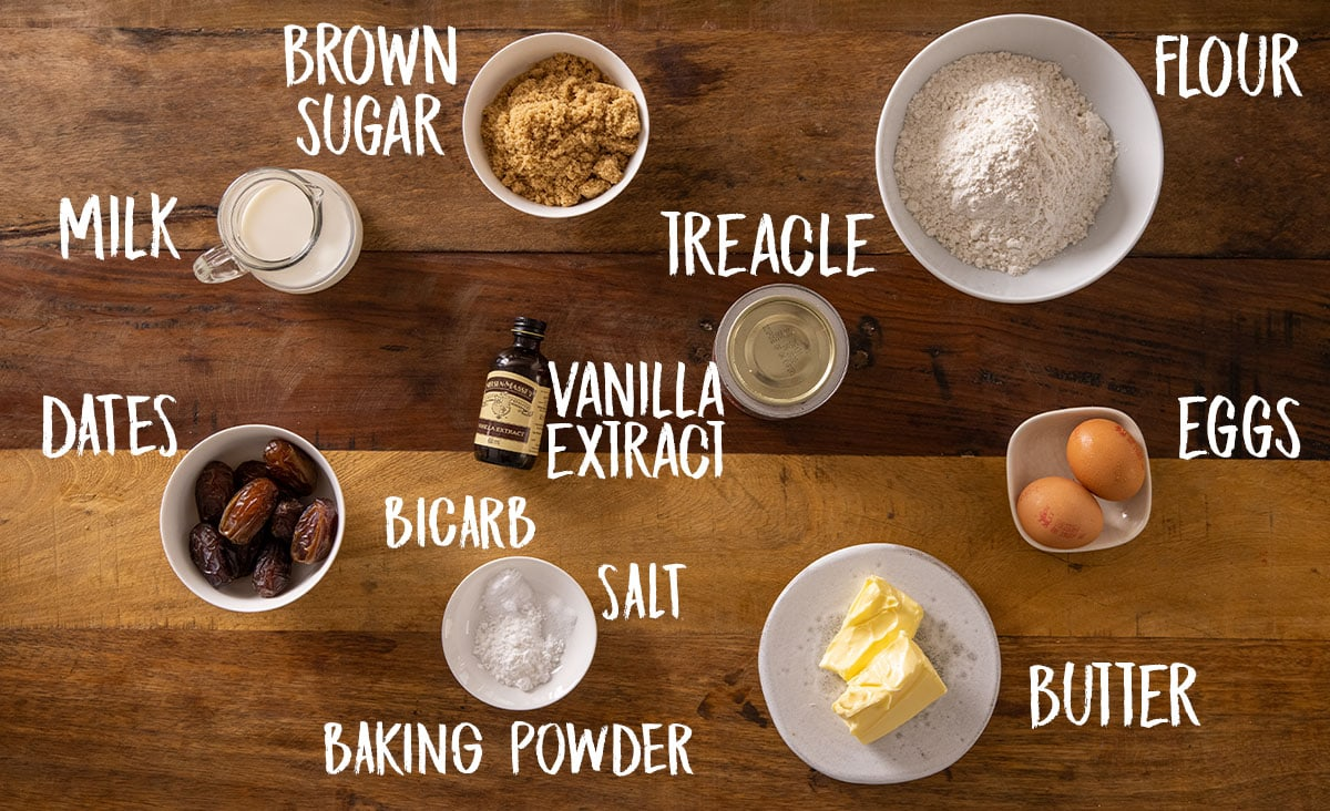Ingredients for sticky toffee pudding on a wooden table