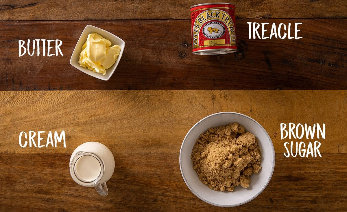 Ingredients for sticky toffee sauce on a wooden table